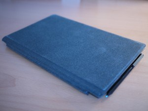 Surface Pro with Cover and Stylus attached magnetically to the side. Just bump it and it will drop.